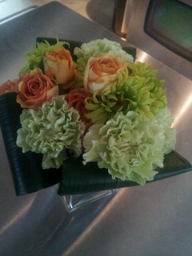 Green carnations and spray roses.