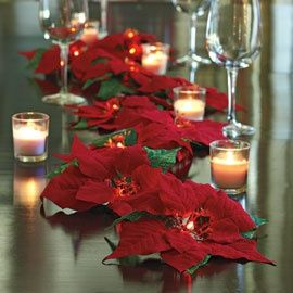 Lighted Poinsettia Garland - Cordless. Can do on the table, a sideboard table, or a table in the living room/entryway!    BRILLIANT!! So pretty  I bet you can find cheap poinsettia decorations at walmart or d.t.
