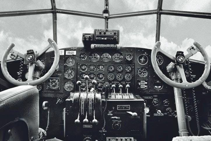 The simple and elegant Ju 52 cockpit. This is such a classic control panel and view that it has been used in watch advertisements fairly recently. Are those BMW symbols on the steering wheels?   Read more: http://worldwartwo.filminspector.com/2014/07/junkers-ju-52-flying-toolshed.html#ixzz4FvmWM2Su  Under Creative Commons License: Attribution  Follow us: @jamesjbjorkman on Twitter