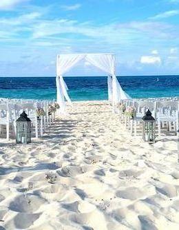Beach Wedding Set Up At The Alexandra Resort Turks Caicos Beautiful Beach Wedding Beach Wedding Turks And Caicos Wedding