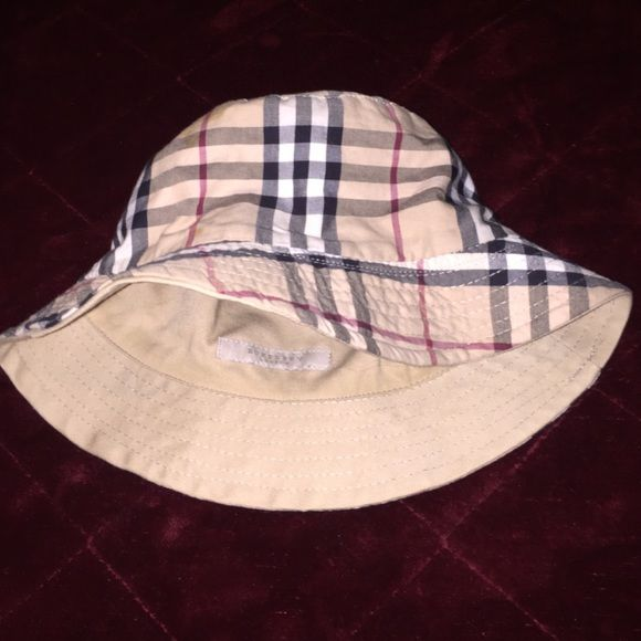 Burberry reversible bucket hat This is a Burberry reversible bucket hat..  Nova check on one side afcb465a1b0