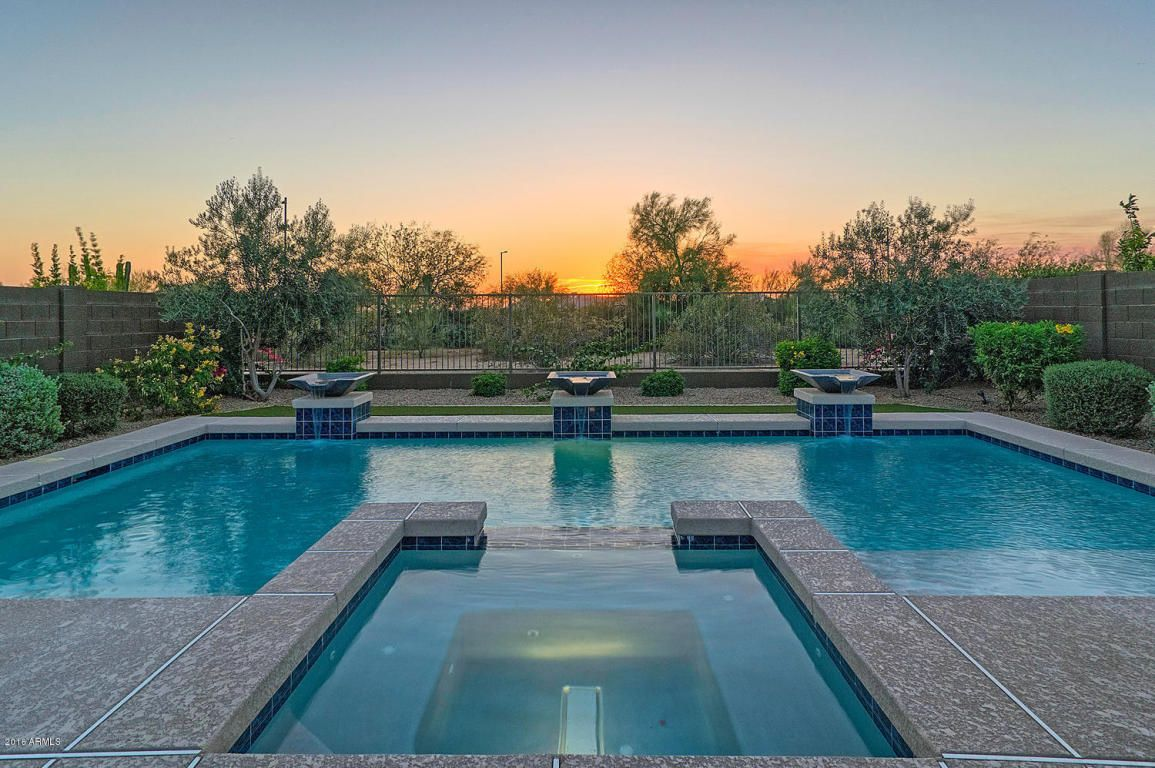 This backyard is truly a private oasis, where you'll be on vacation every day with the sparkling heated pool and spa, built in BBQ, and large covered patio.