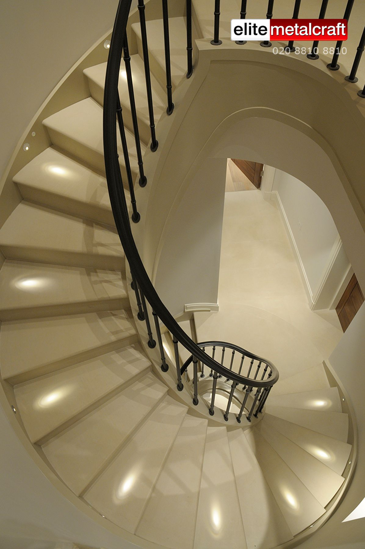This beautifully designed Helical Staircase over 6 floors in the heart of London's fashionable West End   is the epitome of elegance and a testimony to exceptional skills and craftsmanship that is the hallmark of   Elite Metalcraft.     It uses natural stone and beautifully crafted metalwork, finished to a high standard to enhance this luxurious house in Kensington.