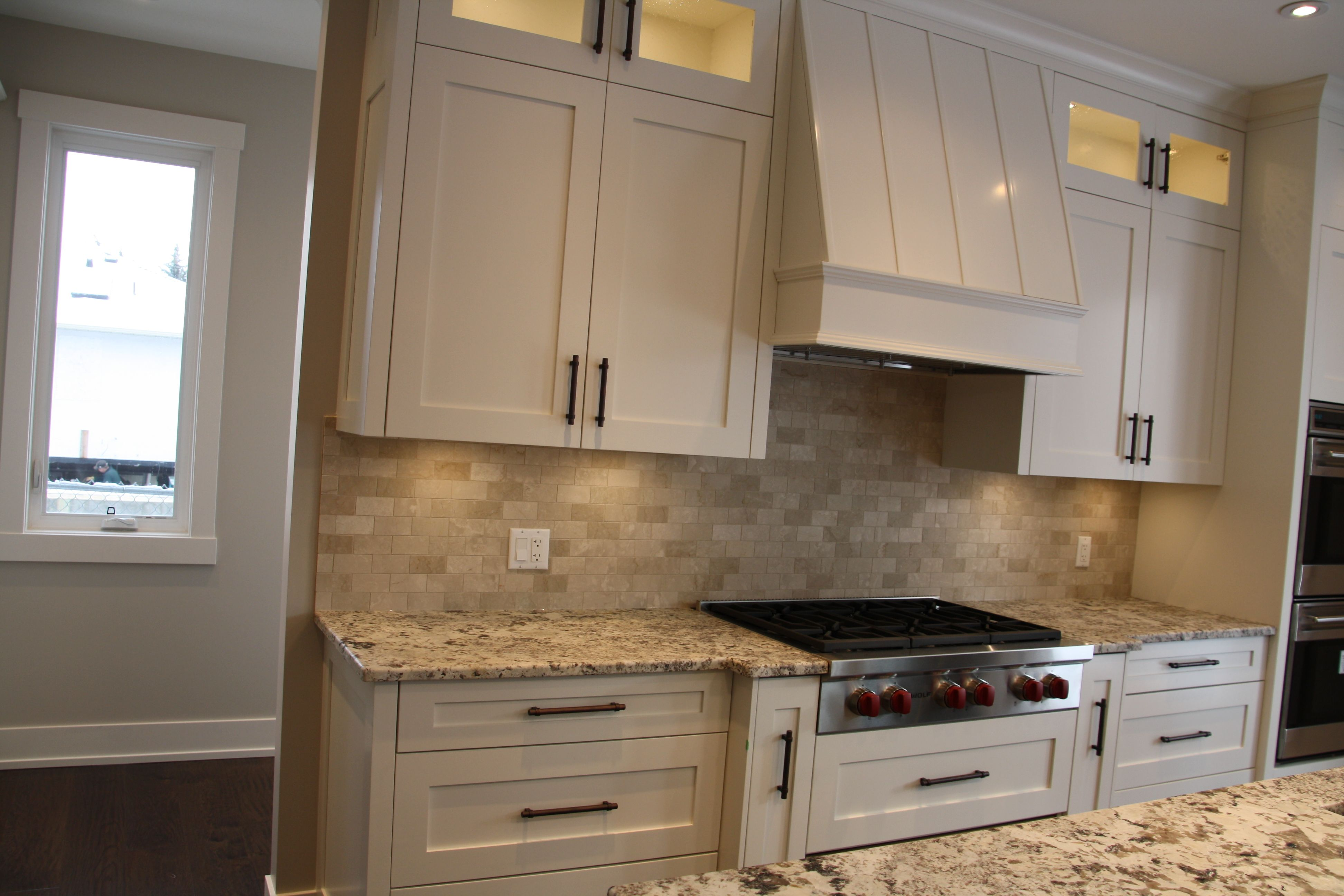 Custom Kitchen Cabinets With Custom Built Range Hood Wolf Range Top With Alaska White Granite Counte Stone Countertops Kitchen Kitchen Cabinets Kitchen Design