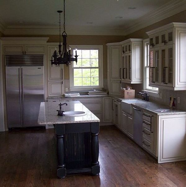 gourmet kitchen with glazed cabinets and distressed island ...