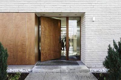 White brick, wood door
