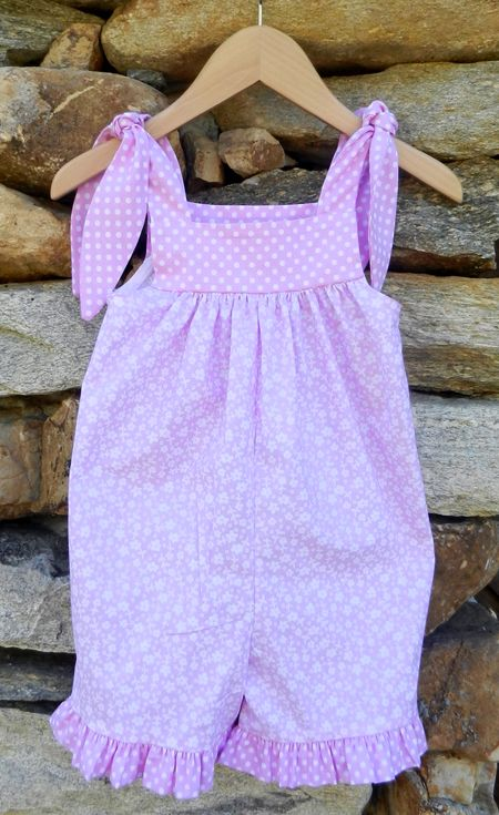 Today's bowtie pocket sundress is made with sweet lilac dot and contrasting calico fabrics. The dress features bowties on the pockets and matching bowtie detail on the back. Dress falls just at the knee and matches our other girls flash sale item today for coordinating sister outfits. Was: $56 Now: $30.
