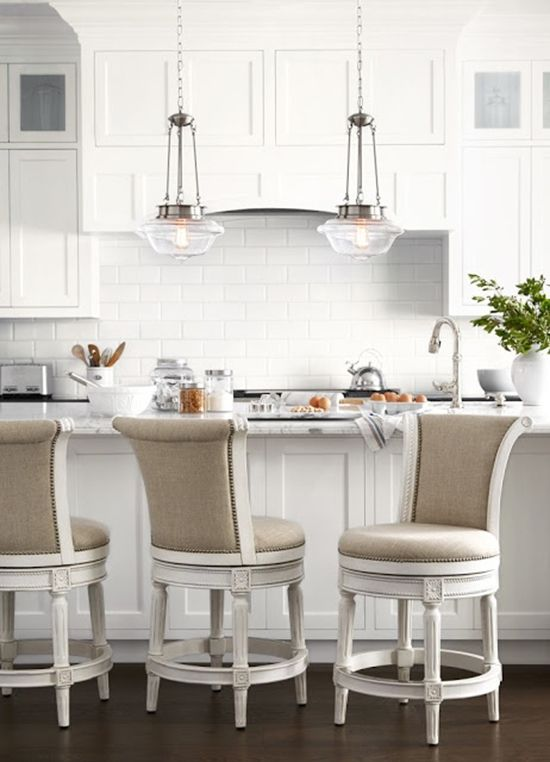 Traditional white kitchen with glass pendant lights over kitchen ...
