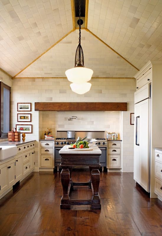 vaulted brick ceiling + pendants + wood beam detail in rustic chic kitchen via chris barrett