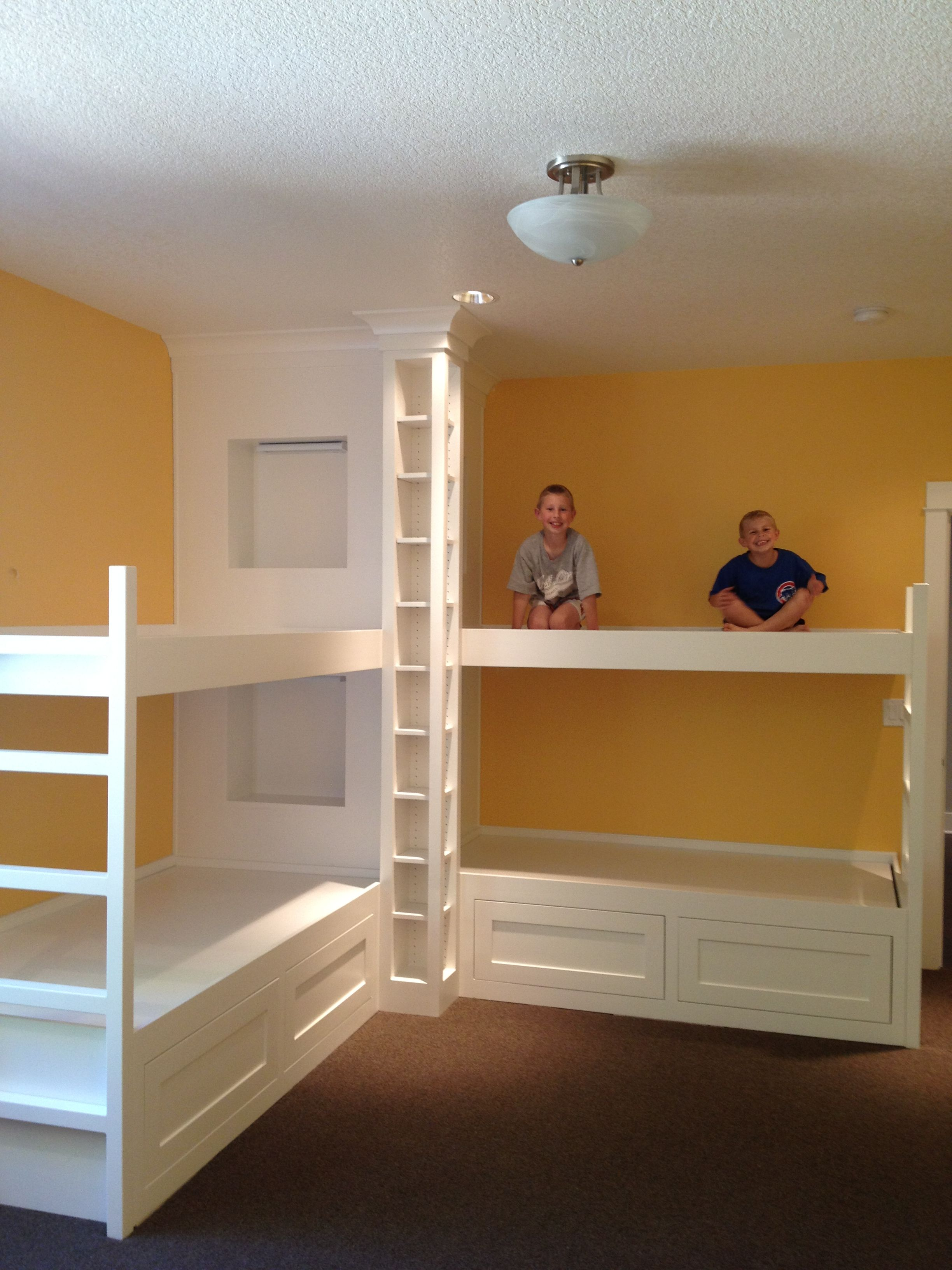 Custom bunk beds open floor plan white kitchen built in for Bed nook ideas