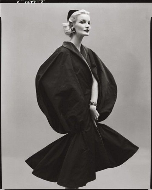 Sunny Harnett wearing a cape by Jean Desses, Paris, 1954. Photo by Richard Avedon.