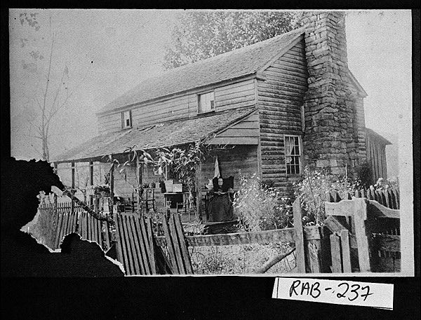 Near Wolffork, 1907. Nancy Adeline Keener Dickerson sitting on the porch of the Dickerson home place.