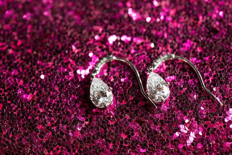Gorgeous earrings for the bride | A Winter Valentine's Day Wedding at Running Deer Golf Club