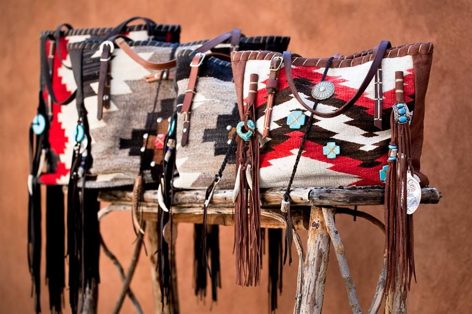 THE TOTE COLLECTION  Navajo Handbags made from blankets / rugs, vintage horse tack, and deer, elk or cowhide leathers. I embellish the bags with vintage trade beads, turquoise, coral, nickel silver/German silver Concho buttons, nickel silver spots/studs, and deer antler tips