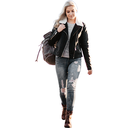 Woman carrying her backpack and walking towards camera ...