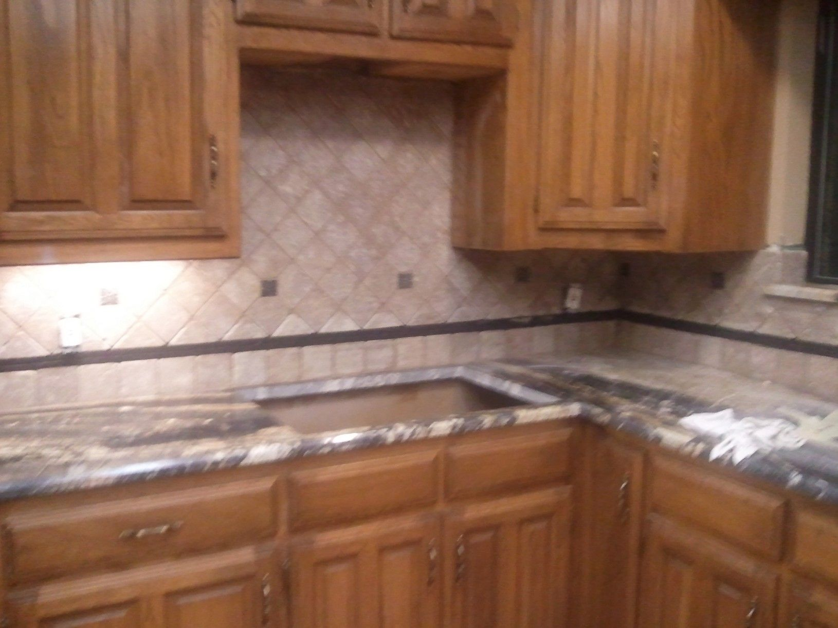 Backsplash in too!!
