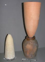 Until the late 19th century, refined sugar was sold as cones called sugarloaves. here you see both the mold and the cone.