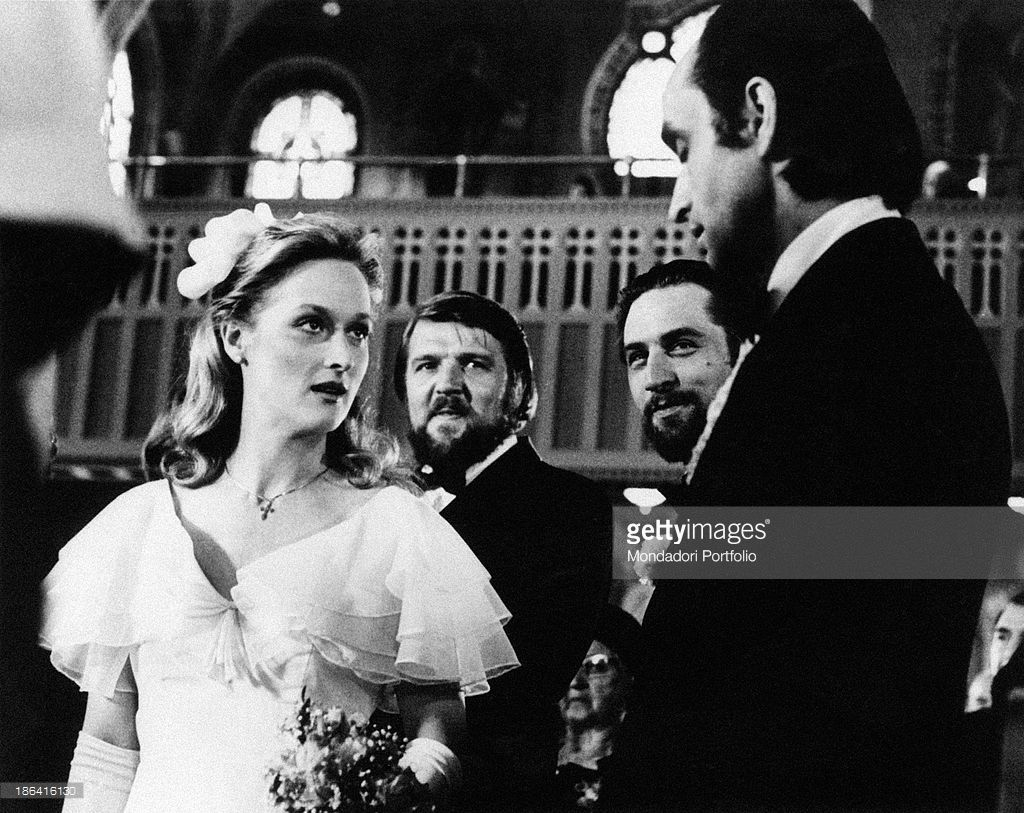 The bridesmaid Linda, played by Meryl Streep in a scene of The Deer Hunter by Michael Cimino, glances at John Cazale, guest to a Russian Wedding into an American Orthodox church together with Chuck Aspegren and Robert De Niro. Cleveland (USA), 1978.   (Photo by Mondadori Portfolio via Getty Images)