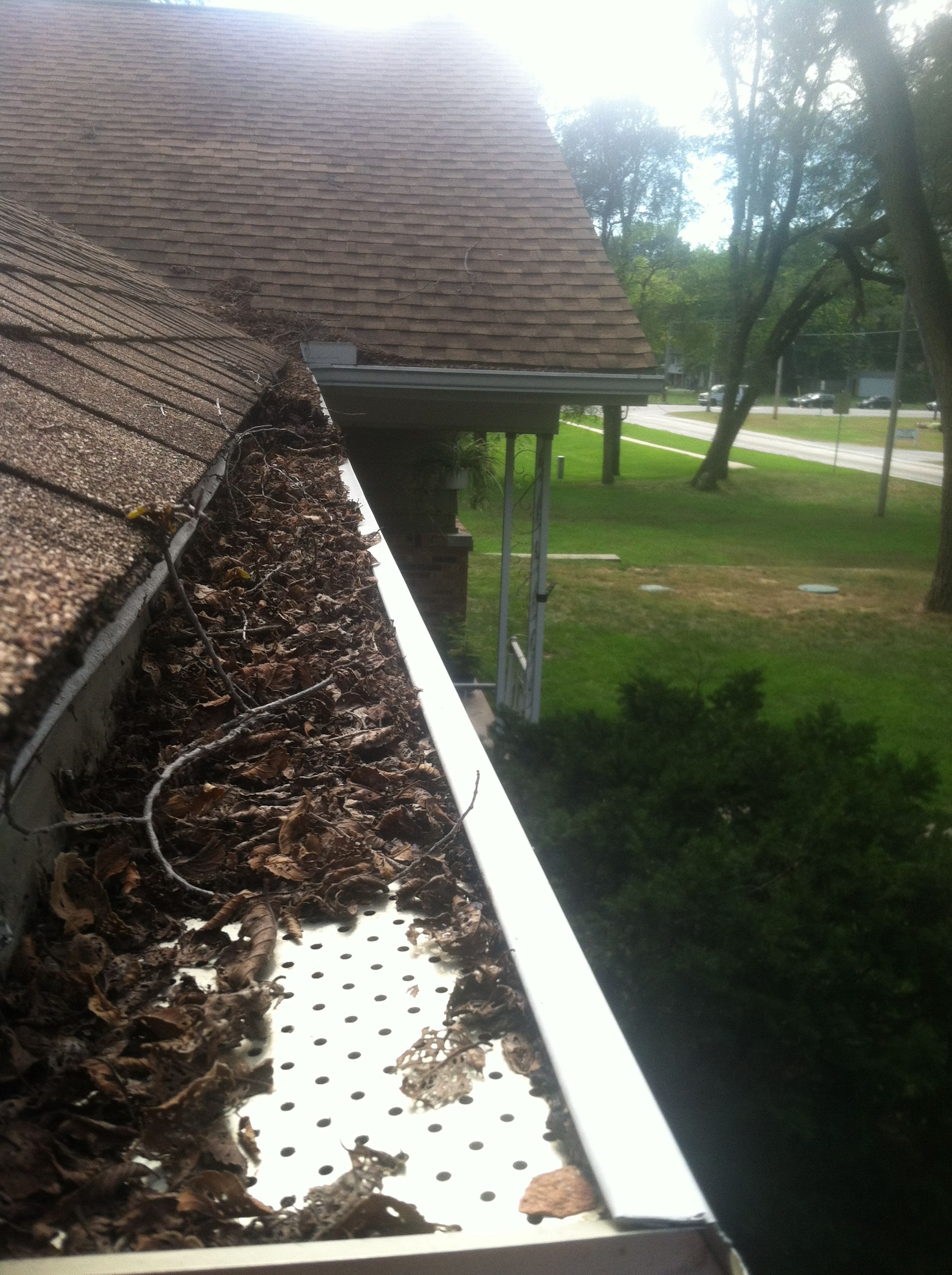 Leaf Relief We Wiped Away Debris So You Can Clearly See The Gutter Guard Beneath Fail Get The Best Gutter Gutter Guard Gutter Protection Cleaning Gutters