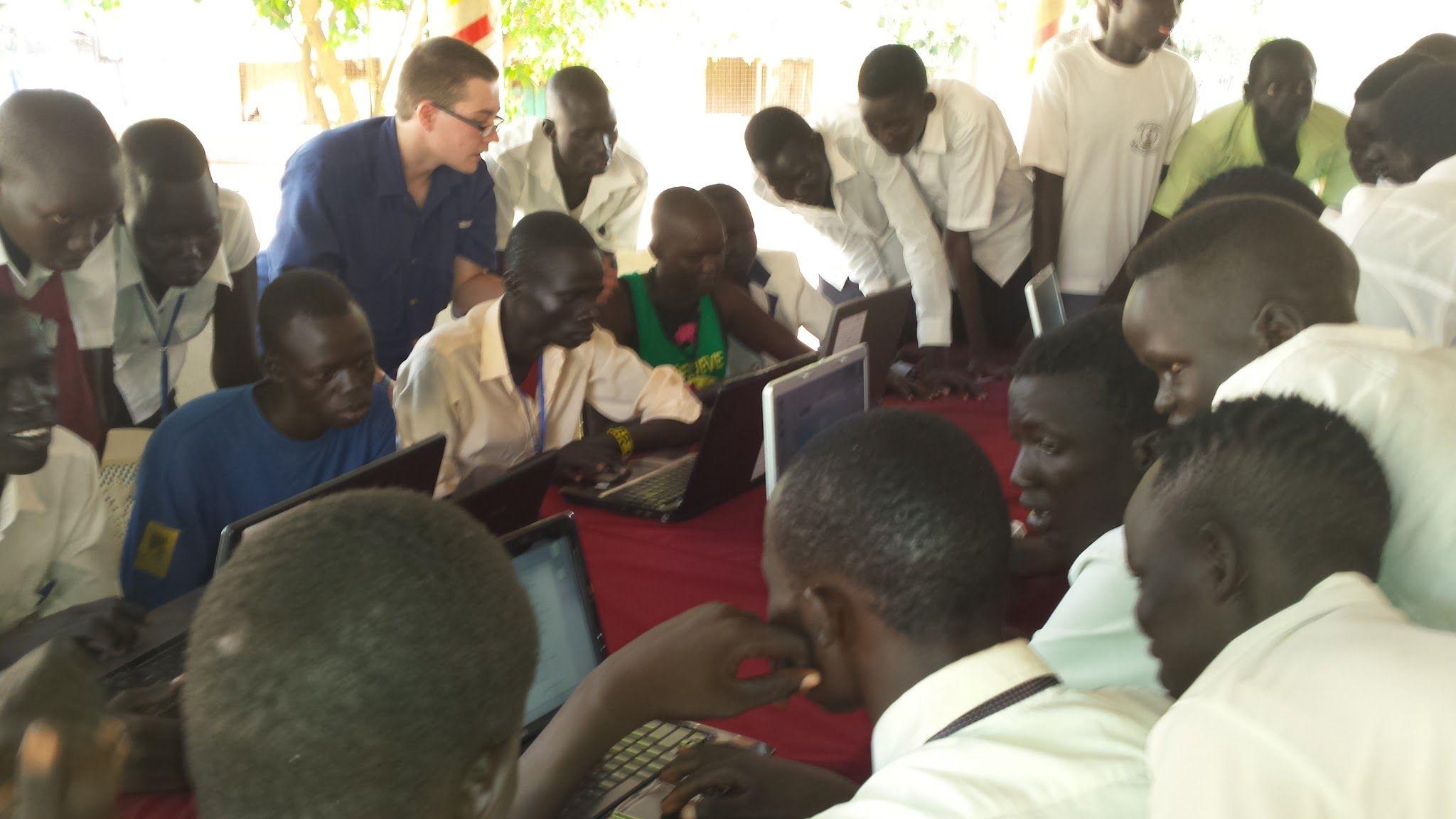 Volunteer teaching students basic internet skills.