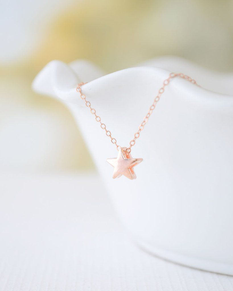 Rose Gold Star Necklace by Olive Yew This cute little star necklace