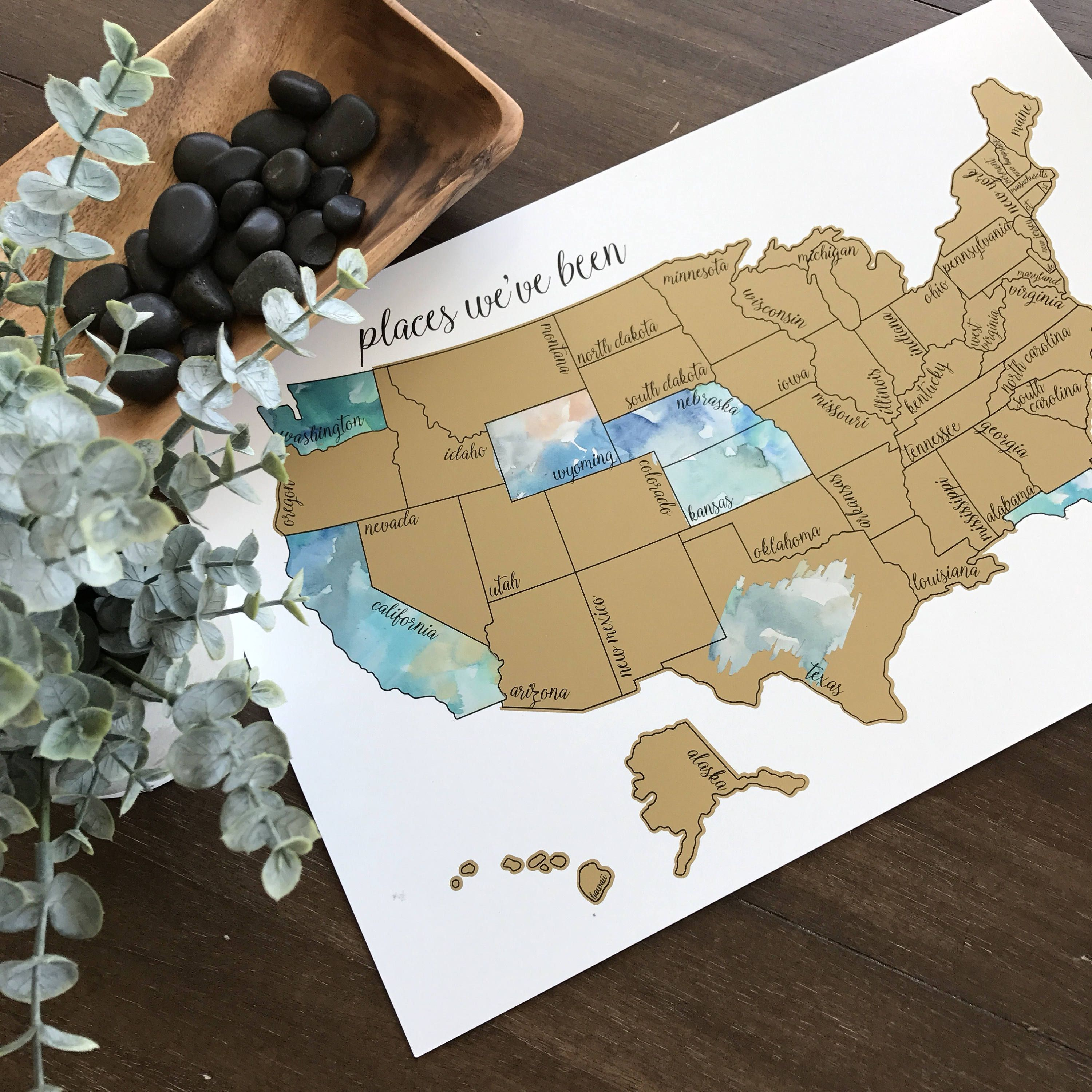 with a printed scratch map designed