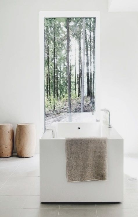bathtub with a view, wood stools, white walls, forest