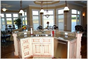 angled kitchen island designs. Angled center island with granite stepped top allows for entertaining in  the kitchen