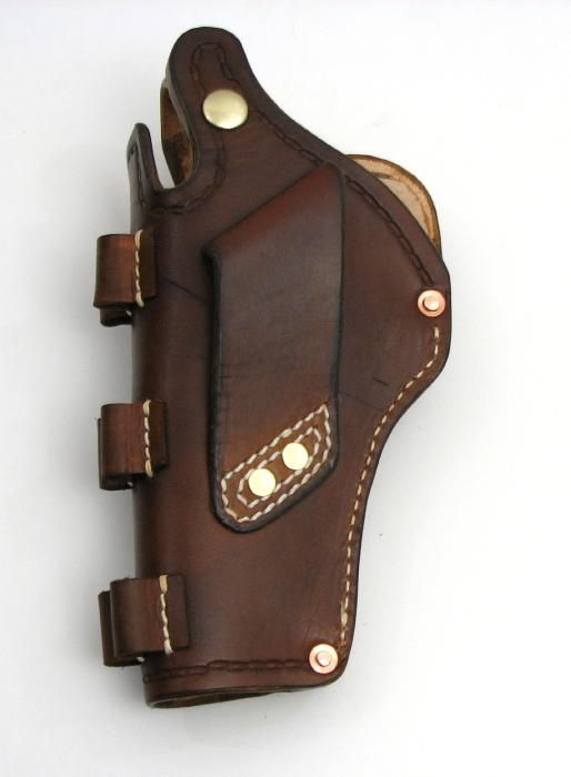 RUGER GP 100 CUSTOM LEATHER CROSS-DRAW HOLSTER - Picture 6Loading that magazine is a pain! Get your Magazine speedloader today! http://www.amazon.com/shops/raeind