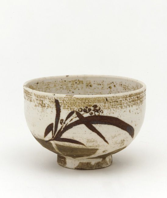Tea bowl. 1630-1650. Edo period. Porcelain with iron decoration under colorless glaze. H: 8.3 W: 12.9 cm. Arita, Japan. This porcelain tea bowl is decorated and glazed in a manner more typical of Korean or Korean-inspired stoneware bowls. Between the 1630s and the 1720s, a kiln operated at the Japanese trading enclave near Pusan, in Korea, to make tea-ceremony wares for the Japanese market.