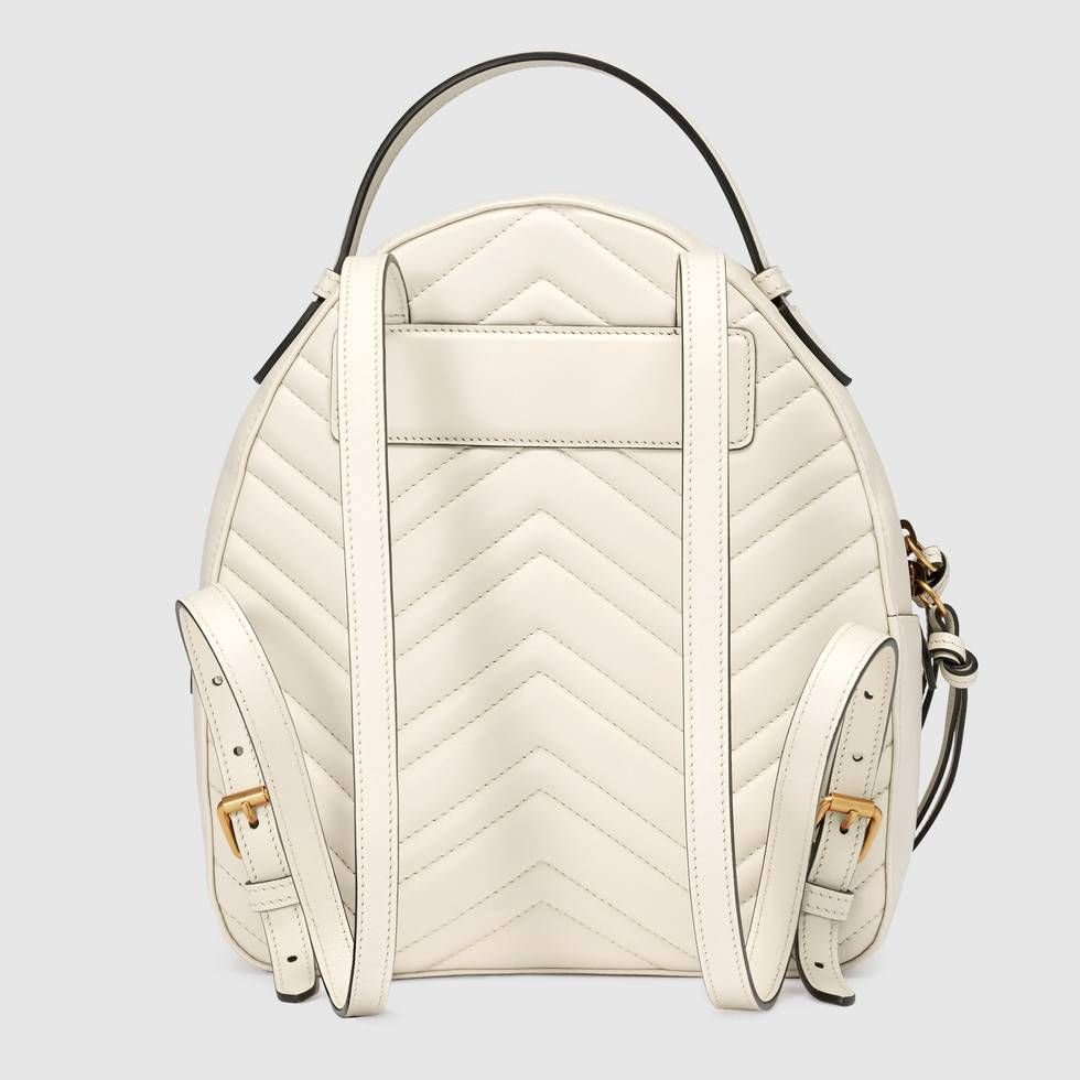 937cd963903 Shop the GG Marmont quilted leather backpack by Gucci. The GG Marmont  backpack has a