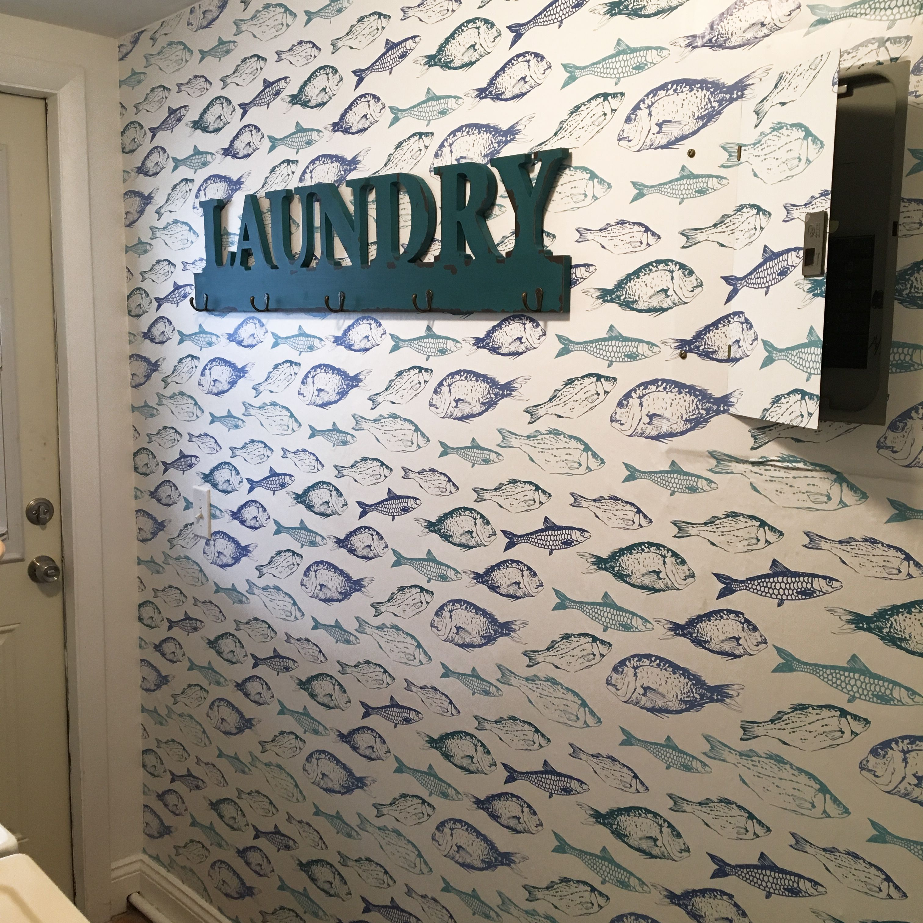 Give your laundry room a sprucing up with this fish wallpaper Cover your breaker box