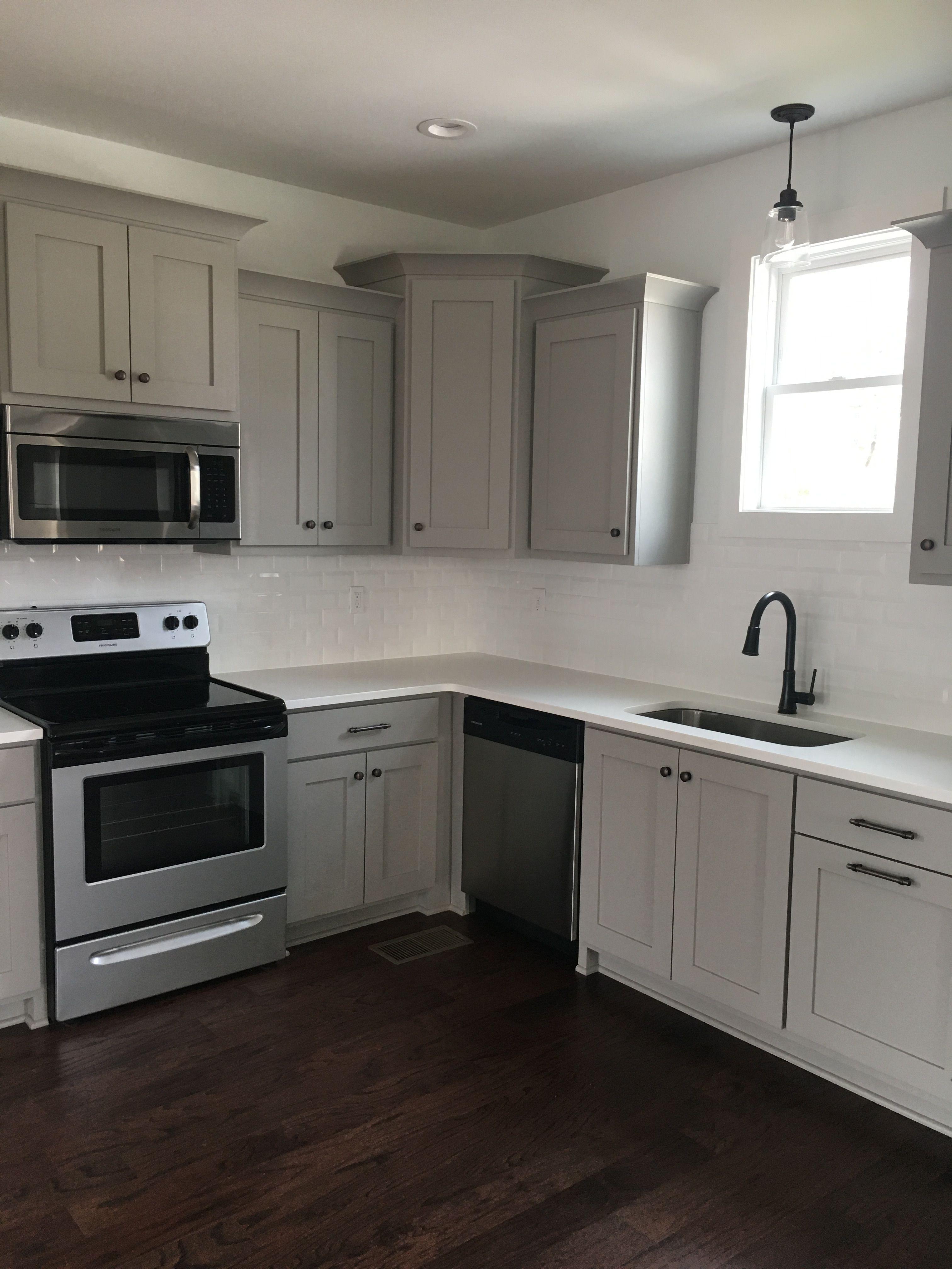 Gray kitchen cabinets white quarts countertops subway tile
