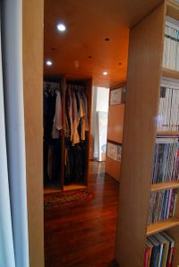 Entrance to computer work area under loft bed showing closet space