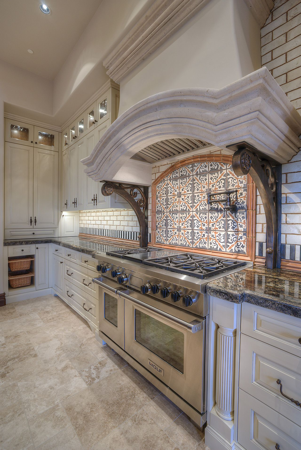 Luxury Kitchen with White Cabinetry This Custom Stone Hood sits