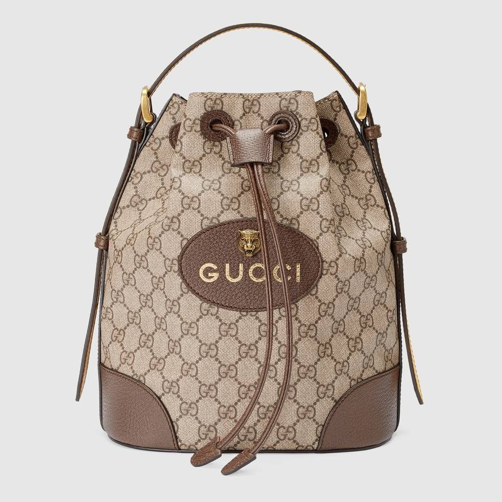 Shop the GG Supreme backpack by Gucci. A drawstring backpack with a bucket  shape made in soft GG Supreme a829d29f0155