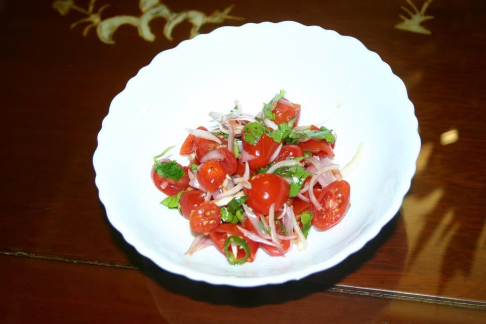 Cherry tomato salad: mustard oil, imported Bangladeshi onions, green pepper, organic cilantro, and salt to taste.