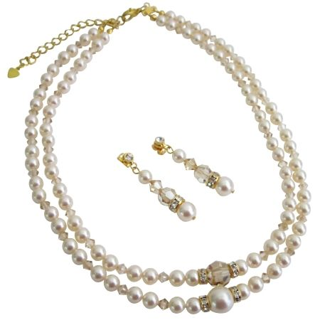 Nothing compares to the dazzle of Swarovski Ivory Pearls with gold rondells to say perhaps the splendor of true love with magnificient beutifuly jewelry for her to gift. We also customize bridal bridesmaid flower girl prom in Swarovski Collection & latest style & upcoming designs. This is very beautiful delicate sleek & elegant Necklace Set made with Swarovski Double stranded Ivory Pearls with Golden Shadow Crystals & 22k Gold Plated Rondells spacer