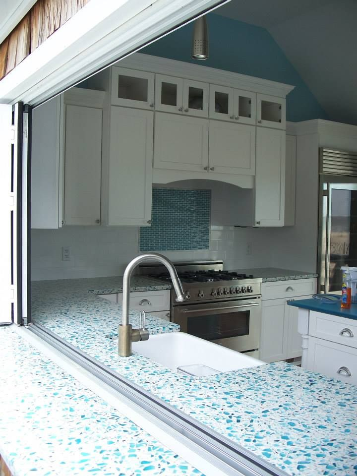 This Floating Blue Vetrazzo Kitchen Is The Perfect Choice For Cantilevering Through The Exterior Kitchen Design Color Glass Countertops Kitchen And Bath Design