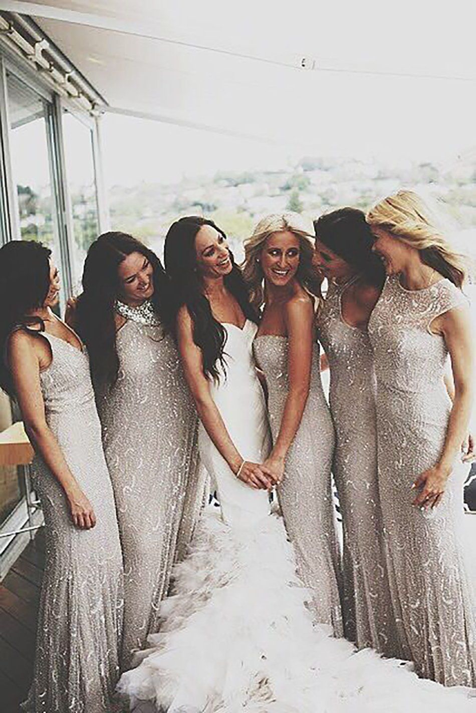 Metallic wedding dress  Bride and bridesmaids wearing silver sequined dresses  Someday