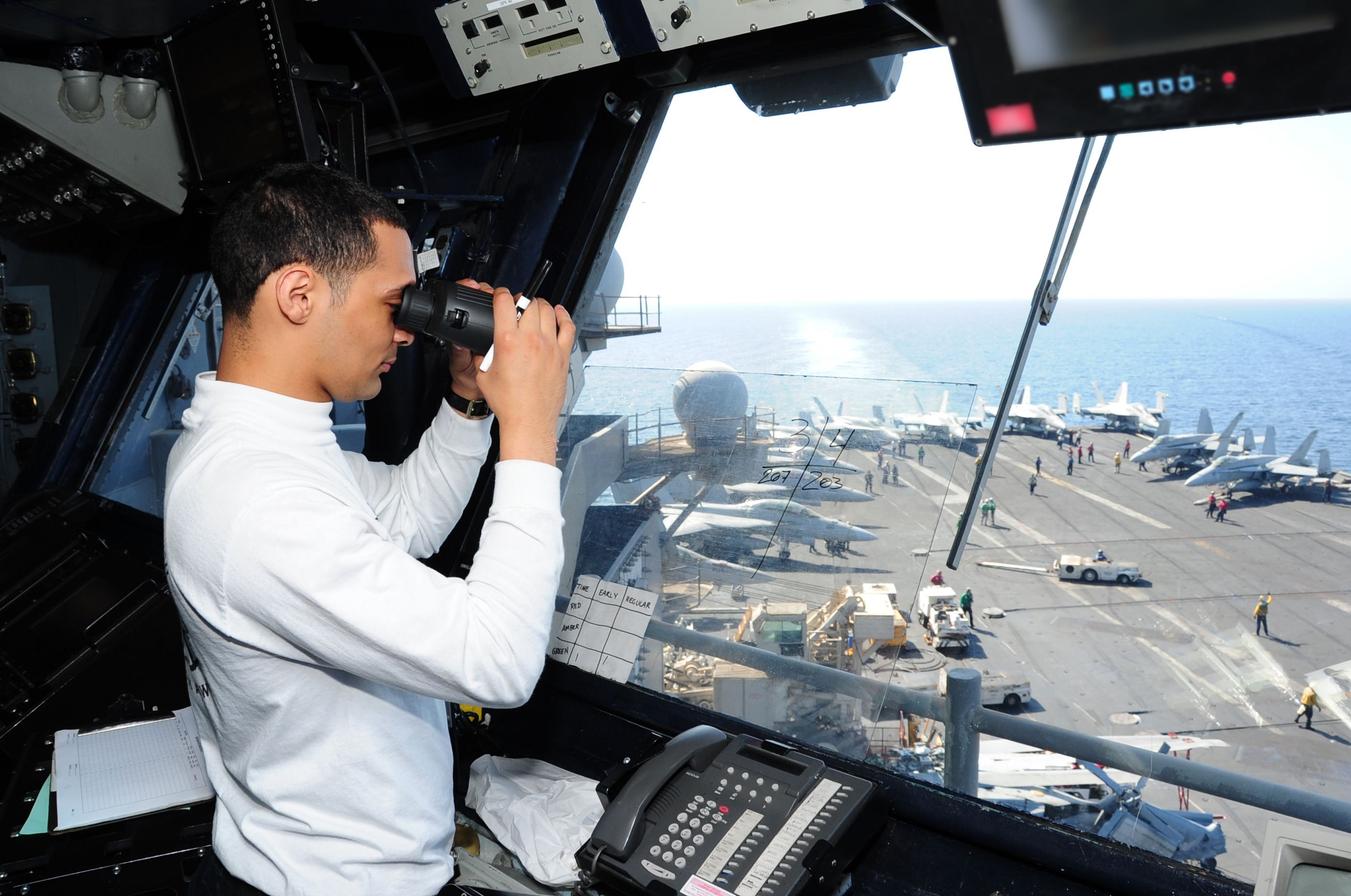 141010 N Cz979 003 Aviation Boatswain S Mate 3rd Class Matthew Reyes Observes Flight Operations From Primary Flight Contr Aircraft Carrier Flight Deck Aviation