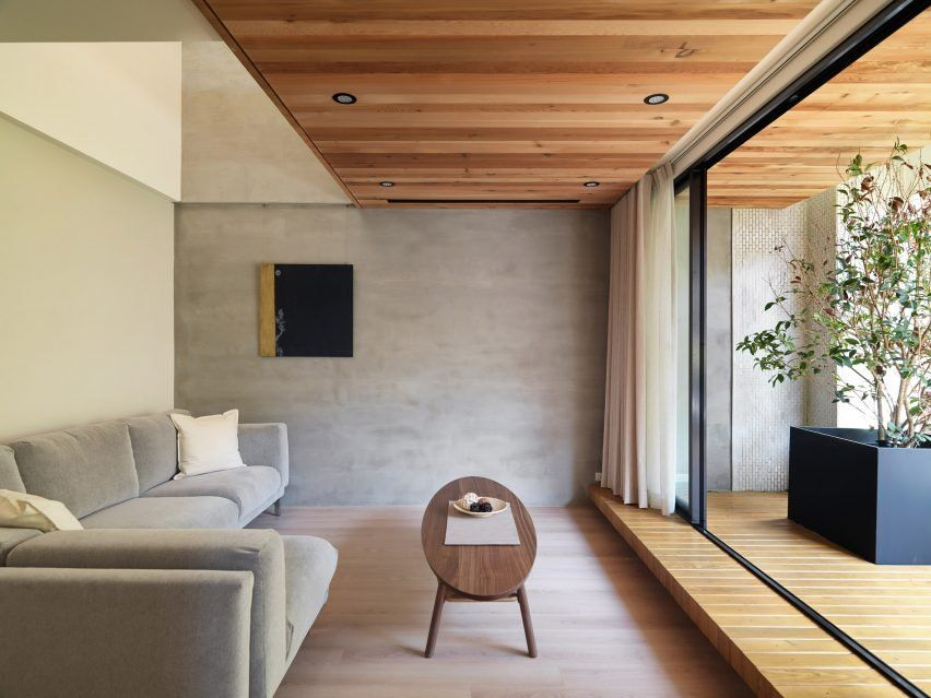 Glass doors open onto decked terraces at Taiwanese house renovation ...