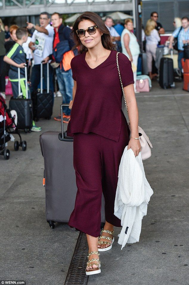 Glam: Chloe Lewis looked the most fashionable of the lot in a burgundy co-