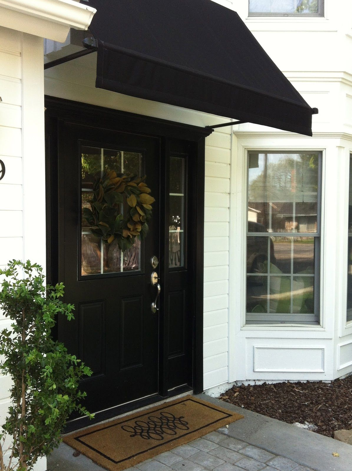 Black door black awning and white siding are a classic for Small entry door