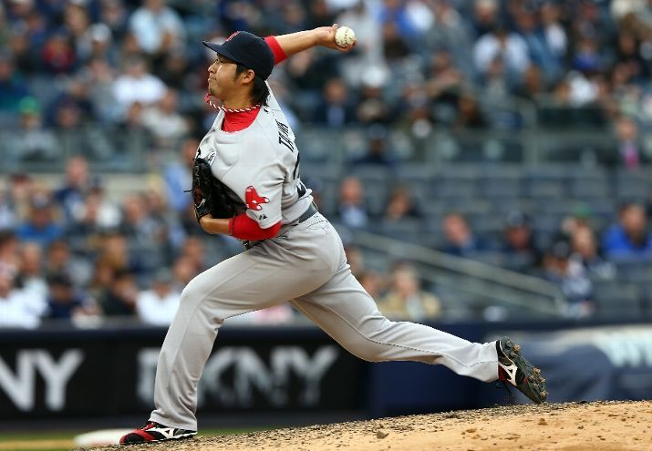 NEW YORK, NY - APRIL 01: Junichi Tazawa #36 of the Boston Red Sox delivers a pitch against the New York Yankees during Opening Day on April 1, 2013 at Yankee Stadium in the Bronx borough of New York City. (Photo by Elsa/Getty Images)