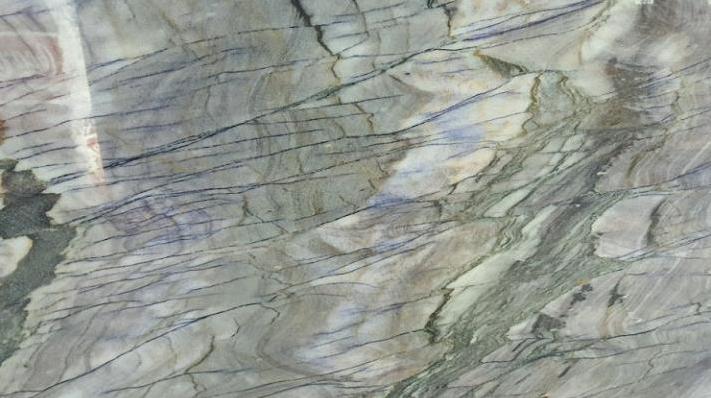 An Amazing Slab Of Arizona Shadow Quartzite Seen On The Floor Of One Of Our Boston Granite Exchange Showrooms Granite Quartzite Countertops Quartzite