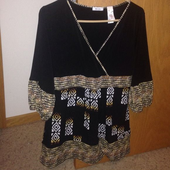 Very cute Liz and Co, tribal style shirt Cute on This is so unique from Liz&co so cute on . This is on Trend with a Tribal design . Check out all the pictures for information on the details !! 95 % polyester and 5 % spandex !! This is flawless and SUPER cute !! Super deal really nice . In perfect condition .  Liz&co Tops