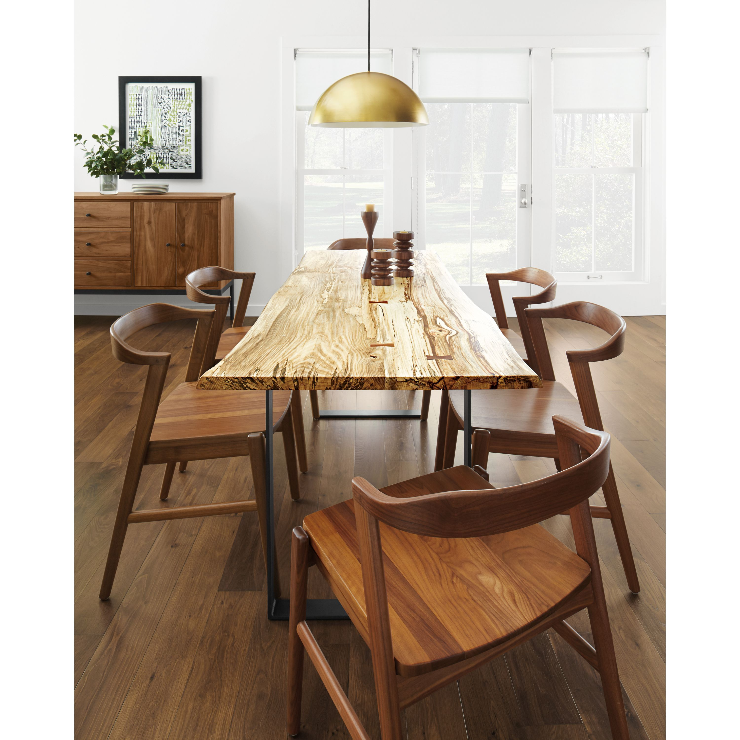 Each Chilton table features a shape and grain as unique as the tree it came from. A solid slab of wood is sanded and finished, braced with walnut butterfly joints in any areas requiring extra support, and secured to a hand-welded natural steel base. The best part? You can choose the exact top you like best for a one-of-a-kind look. Material: Wood; Natural Steel