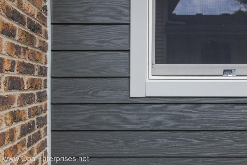 Siding Replacement With James Hardie Iron Gray Cedarmill Planks Gray House Exterior Exterior House Renovation Red Brick Exteriors