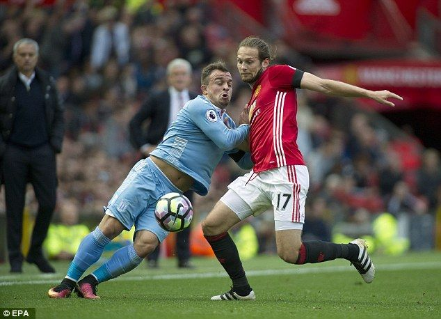 Blind (right) holds off Potters wingerXherdan Shaqiri during the fixture at Old Trafford